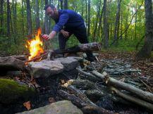 John Ozmore building a fire