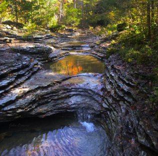 Hobo Falls trickling falls with orange reflection on OHT