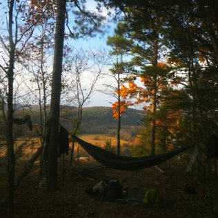 Hammock over Buffalo National River with golden leaves