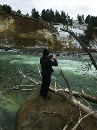 Daniel with binocs at yellowstone river