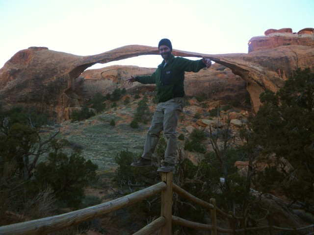 Me balancing on fence at landscape arch