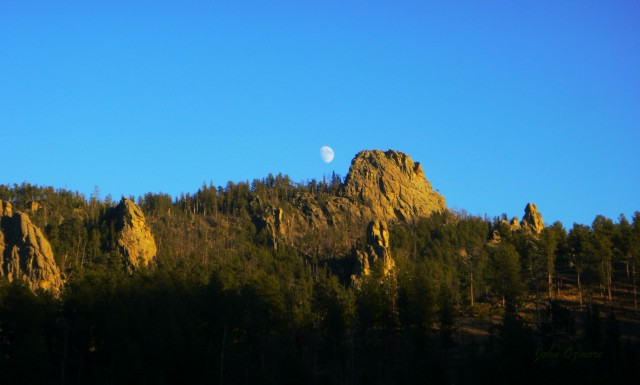 Moon over Sunlit Mountains