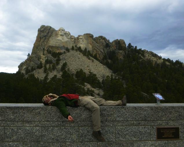 Mt Rushmore face-hugger portrait