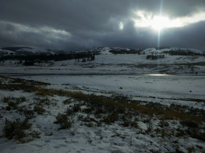 Sun beams over frozen lake in Yellowstone