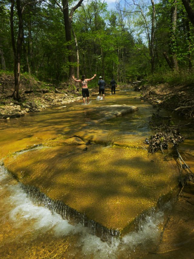 Golden pyramid in creek water